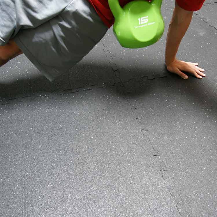 Person exercising on Z-Cycle rubber tiles