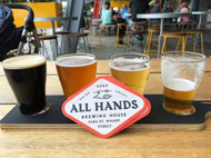 @allhandsbrewinghouse tasting paddle at King Street Wharf.