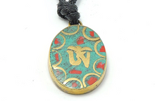 Handmade Tibetan Turquoise and Coral Inlaid Brass Tibetan Om Pendant (Oval)