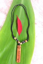 Handmade Tibetan Yak Bone Pendant (Buddha Eye Om Mani)