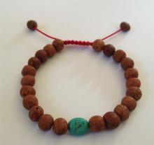 Tibetan Mala Raktu seed wrist mala/ bracelet with Turquoise spacer
