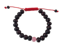 - Rosewood wrist mala with rose quartz spacer