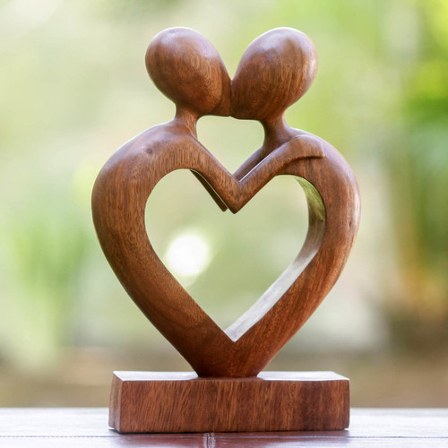Wood sculpture 'Love Flows'