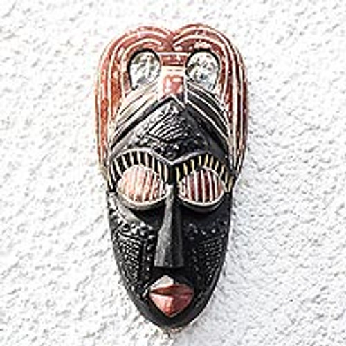 African Mask Depicting a Young Girl 'Awaiting Love'