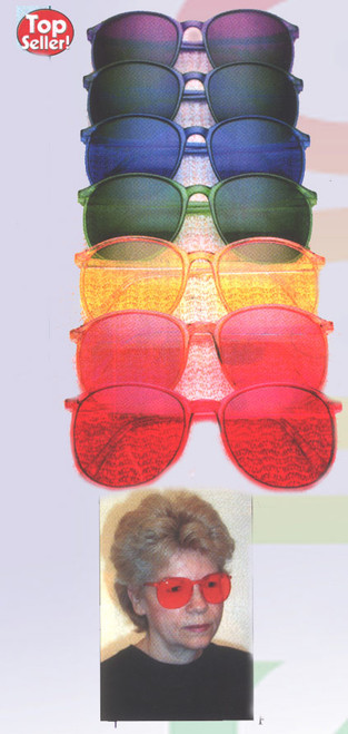 It's fun, it's sun protection, it's mood-enhancing, it's color therapy, all in 7 dazzling color glasses!  Yes, each pair of lightweight sunglasses blocks 95% of damaging UVB, and 60% UVA rays. But color is also a powerful mood regulator which stimulates and corrects imbalances corresponding to the chakra energy centers of the body. Colors can even affect the way in which the pineal glands determine endocrine function. On a psychological level people feel different being immersed in different colors. Wear them for 30-60 minutes per day, or however long you feel the desire.    Red -    root chakra, for energy, power, courage and self-confidence. Orange - the sacral chakra, for sociability, creativity and happiness. Yellow - the solar plexus chakra, for cheerfulness, health and mental clarity. Green - the heart chakra, for harmony, healing, peace and unconditional love. Blue -   the throat chakra, for sensitivity, loyalty, integrity and communication. Indigo - the third eye chakra, for intuition, meditation, awareness and perception. Violet - the crown chakra, for spiritual fulfillment, generosity, selflessness, wisdom            and inspiration.   MAGENTA (PINK, ROSE) ASSOCIATED WITH: Balancing of emotions, for both the over and under emotional. REPORTED BENEFITS: Relaxation, balancing emotions.  AQUA (TURQUOISE) ASSOCIATED WITH: Soothing feeling, purity, calmness. REPORTED BENEFITS: Loving expressiveness.  INDIGO ASSOCIATED WITH: Serenity, stillness, understanding, imagination. REPORTED BENEFITS: Accurate perception, greater intuition and awareness.  VIOLET ASSOCIATED WITH: Creativity, beauty, inspiration. REPORTED BENEFITS: Selflessness, generosity, enhanced artistic ability.  BLUE ASSOCIATED WITH: Communication, personal expression, decisiveness. REPORTED BENEFITS: Clear communication, confidence in speaking, mental relaxation.  GREEN ASSOCIATED WITH: Peace, love, harmony. REPORTED BENEFITS: Rest, relaxation, calmness, stress reduction.  YELLOW ASSOCIATED WITH: Cheerfulness, mental clarity, inspiration, stimulating curiosity and interest. REPORTED BENEFITS: Easing of depression, greater self-esteem, empowerment, confidence.  ORANGE ASSOCIATED WITH: Resourcefulness, sociability, happiness, success. REPORTED BENEFITS: Social confidence, joyfulness, enjoyable relationships, expanded interests and activities.  RED ASSOCIATED WITH: Vitality, self-confidence, feeling of security and safety, courage, power. REPORTED BENEFITS: Energy, confidence, settled, feeling of safety and security. May raise your blood pressure and generate body heat. Wear red only for a short time.