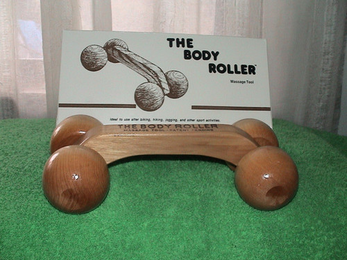 Large solid wood 4 wheel body roller in box.  Great Value will last forever
