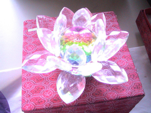 The crystal lotus is rainbow  clear, pink, lavender, or blue.and comes in a silk box