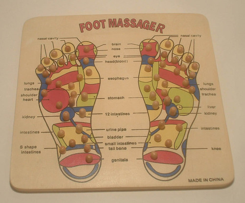 All Wood - Painted Foot Board with Wood pegs that you can stand on to press  on the Main body points.  Measures 12x12.   Comes in a Plastic Bag  Fun to stand on and see what points hurt on the feet that correspond to the various organs and areas of the body.