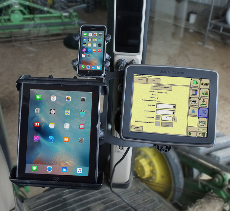 This bracket holds John Deere displays, cell phones and tablets all at the corner post in the cab.
