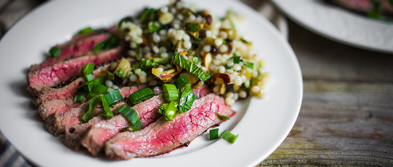 Sriracha Rubbed Bison Flank Steak with Warm Pearl Cous Cous Salad