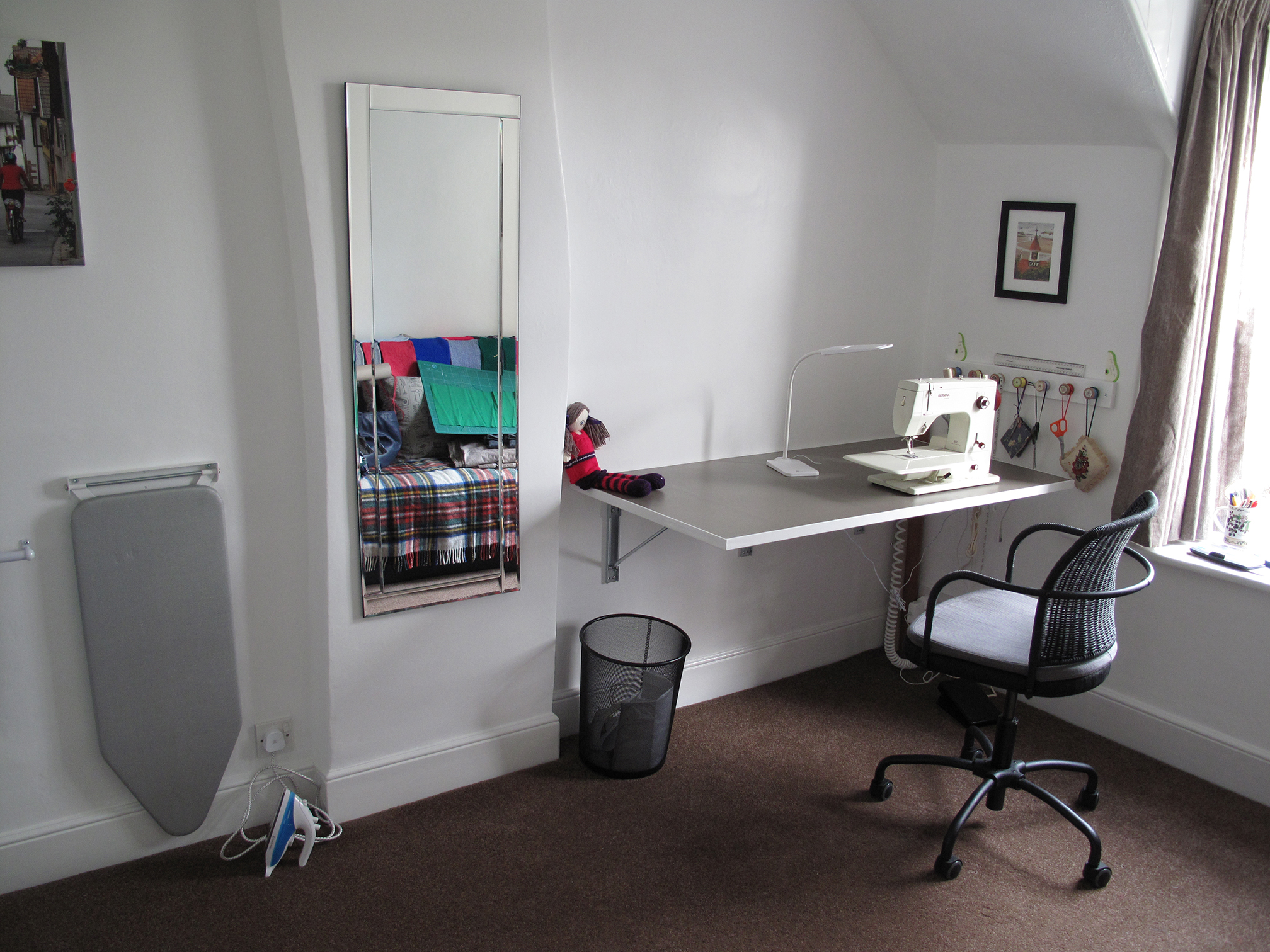 Sewing Room With Compact Ironing Board And Folding Table