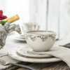 4- Piece Rimmed Place Setting in Embossed Running Horse