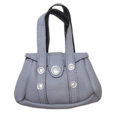 Fits 18 inch American Girl doll Includes: purse Gray purse with faux studs and Velcro dot closure.