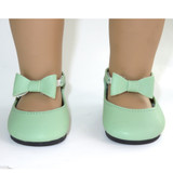 """Fits: 18"""" American Girl doll  Includes: shoes  Light green shoes with elastic straps with bows in front."""