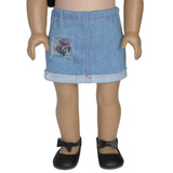 Fits: 18 inch dolls  Includes: skirt  Light blue denim skirt with flower patch, pink thread, and elastic waist.