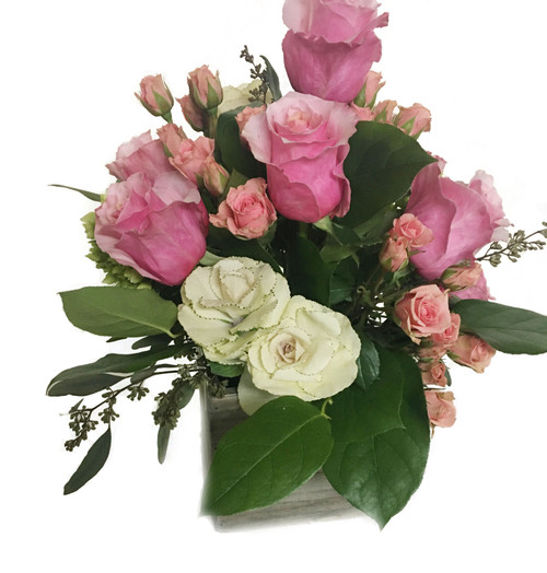 Fresh floral arrangement made with beautiful pink roses.