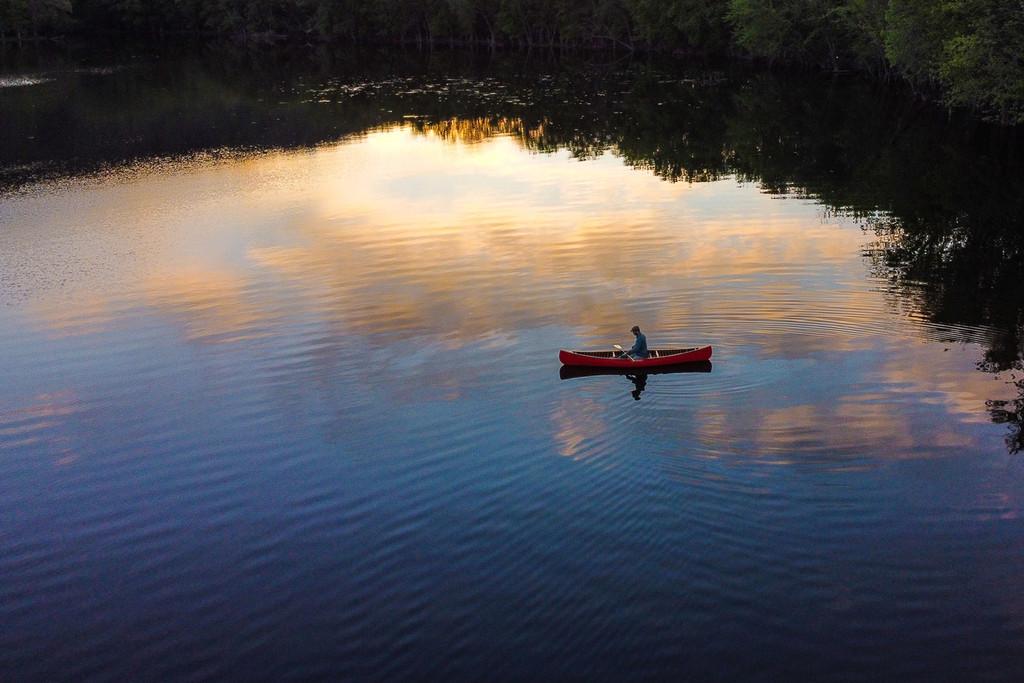 Solo Canoe at Sunrise