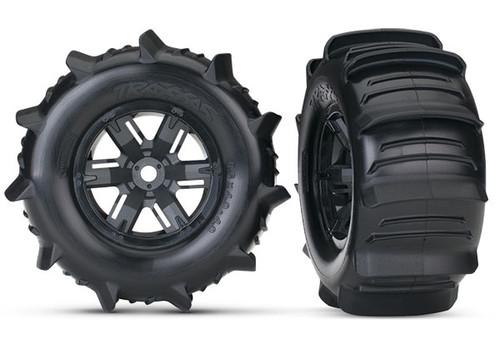 TRA7773 -- Tires & wheels, assembled, glued (X-Maxx® black wheels, paddle tires, foam inserts) (left & right) (2)