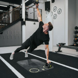 workout mats in use by man