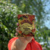 Holding a bag of Door County Maple Coffee
