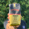 Holding 10oz. Bag of Vanilla Creme Brulee Coffee