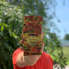 Holding a bag of Door County Maple Ground