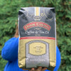 Holding  5lb. bag of Jamaican Blue Mountain Blend Coffee