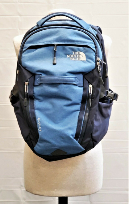 The North Face Surge Dark/Light Blue Backpack  ** Strap Is Tearing**