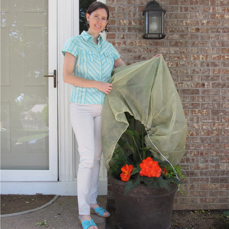Container Cover fits plants up to 3½ feet tall.  Simply drape the cover over the plant and pull the drawstrings to secure it in place. It's that quick and easy!