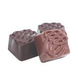 Simple milk chocolate molded into squares with our signature CCC.