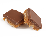 A three layer bar:  freshly roasted and salted cashews, our own soft & buttery caramel, all topped with creamy milk chocolate.