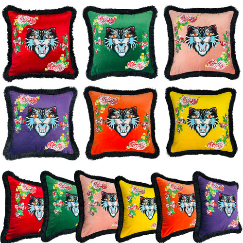 Crafty, couture, and exotic, these pillows will remind your guests they're in the presence of an eccentric glamour-puss.