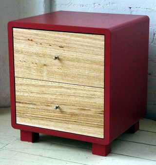 Red cube with ash drawers