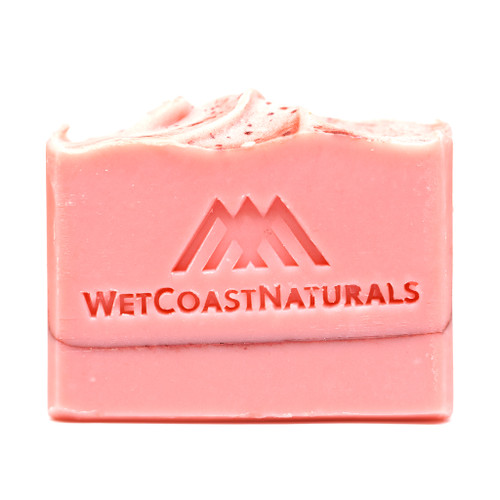 Pink Citrus Bar Soap. Mostly pink with a dark pink bands and a wavy top.