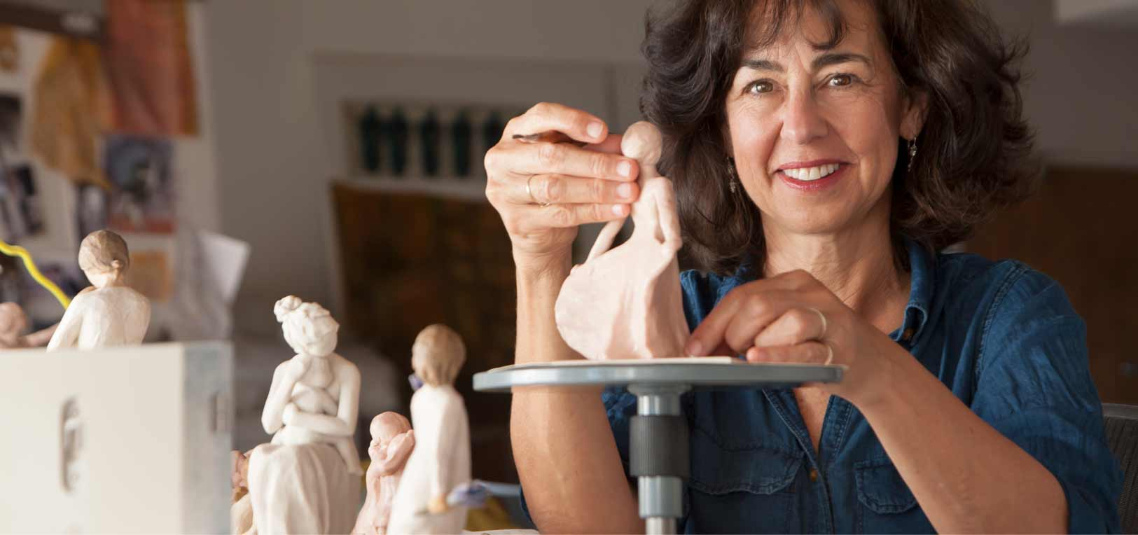 Susan Lordi sculpting a figurine in her art studio