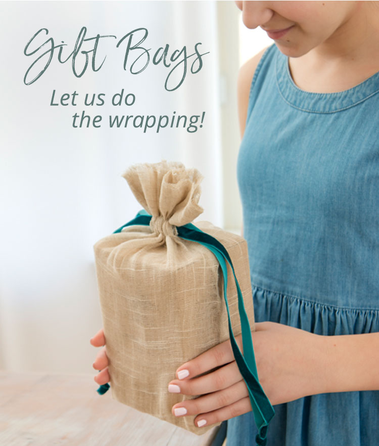 Girl holding gift wrapped in natural linen bag