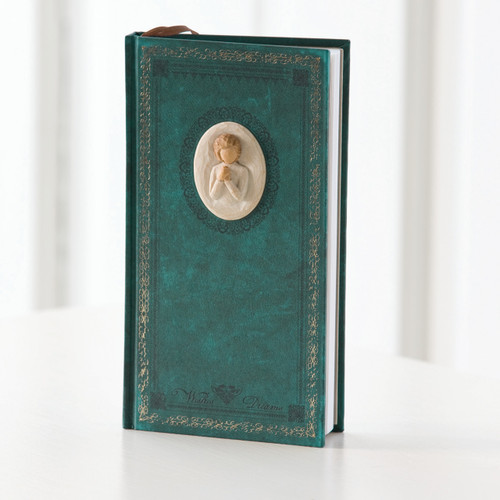 Teal book standing up with small round image of faceless person in white