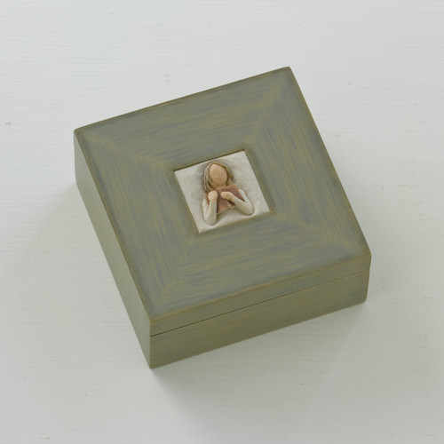 Small light grey wooden keepsake box with carved in image of faceless figurine's face in the center