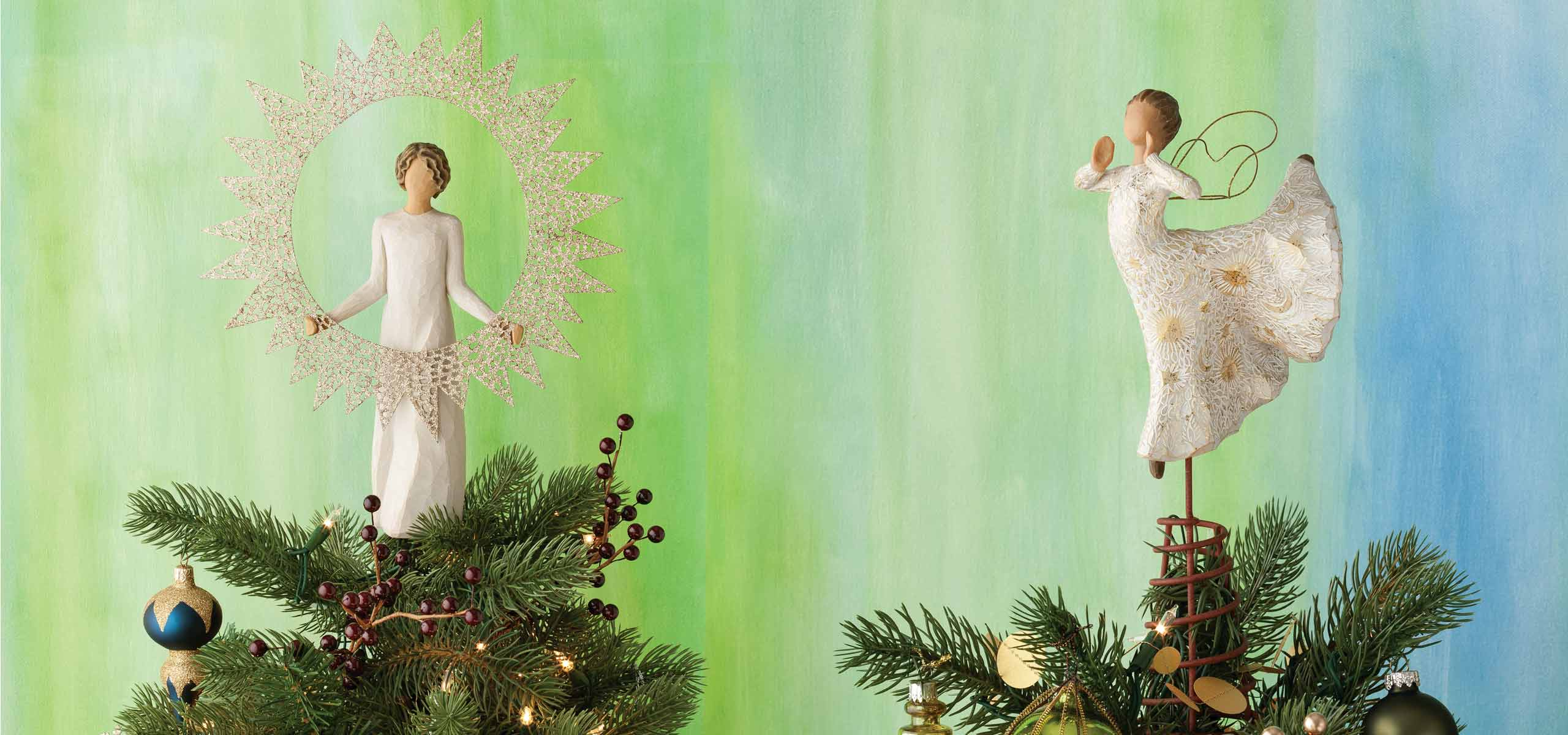 a picture of two tree toppers one is of an angel holding up a the sun as a star and the other of an angel standing on one foot dancing on top of a tree