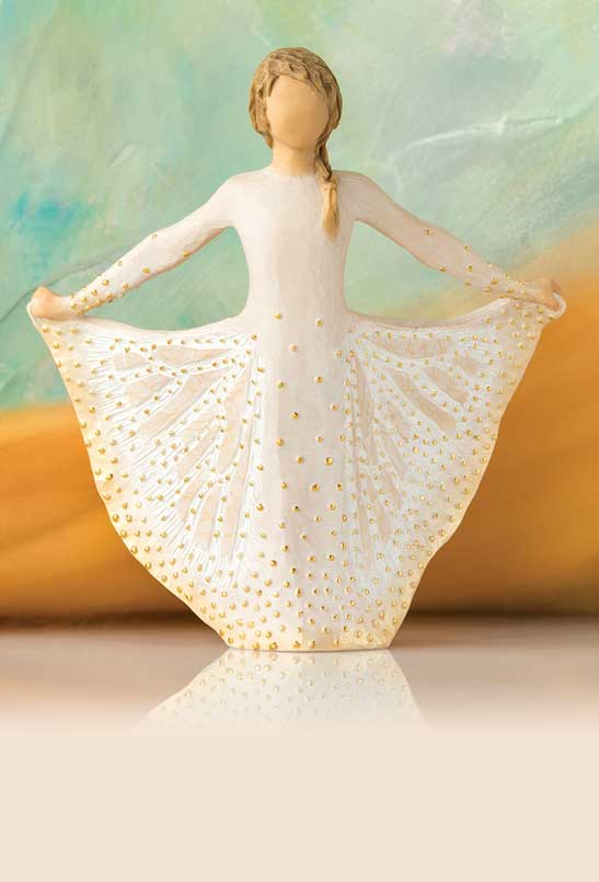 Hand-carved figurine of a girl butterfly decorated in gold dots