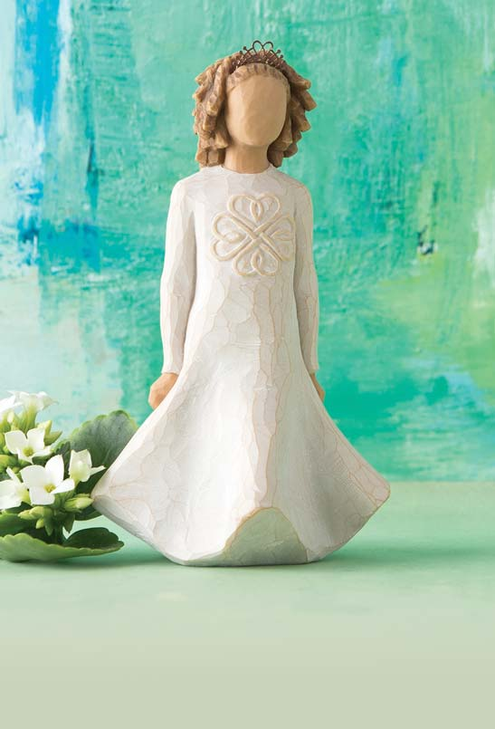 Hand-carved figurine of irish girl in dress with Celtic symbol