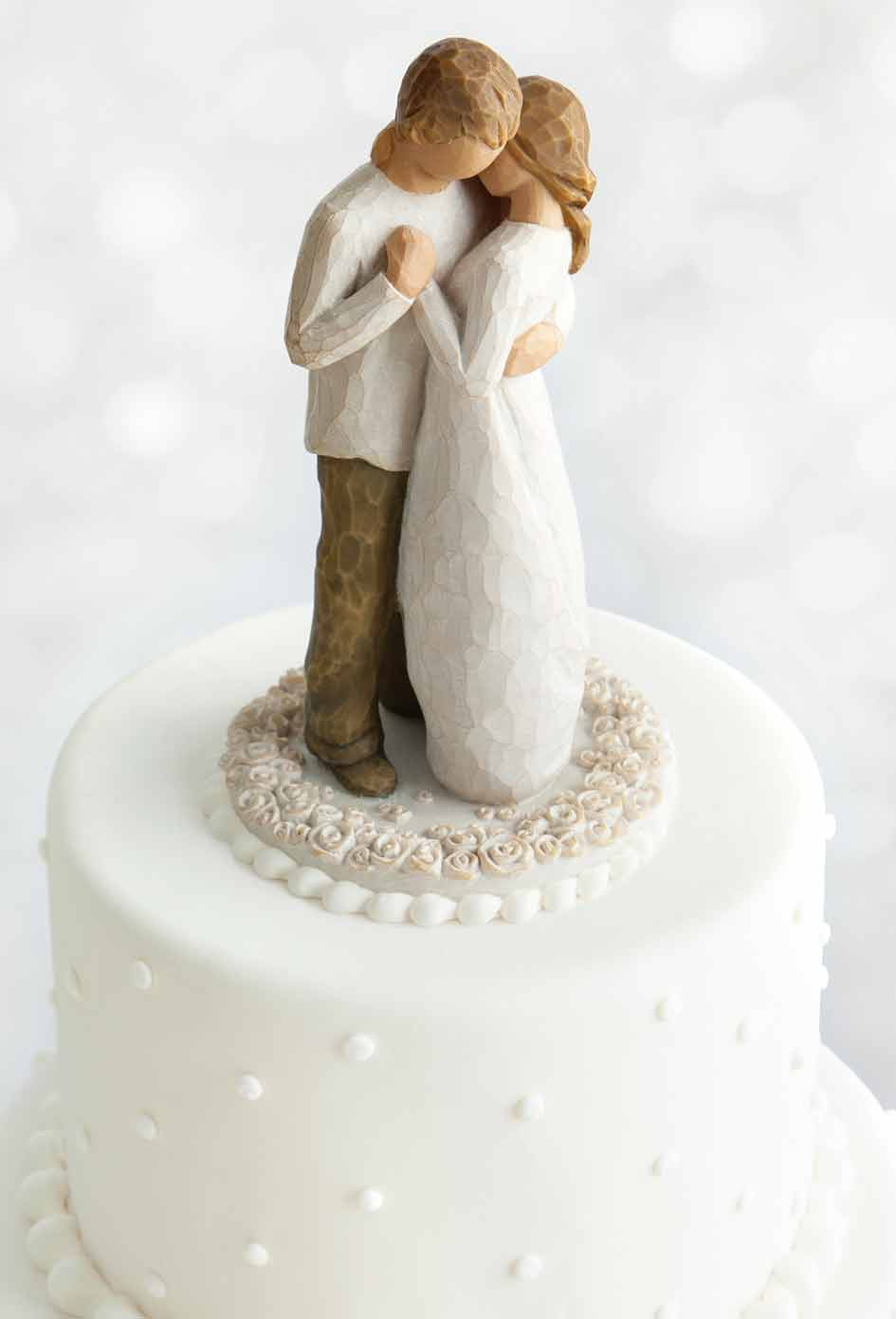 Hand carved figurine of cake toppers
