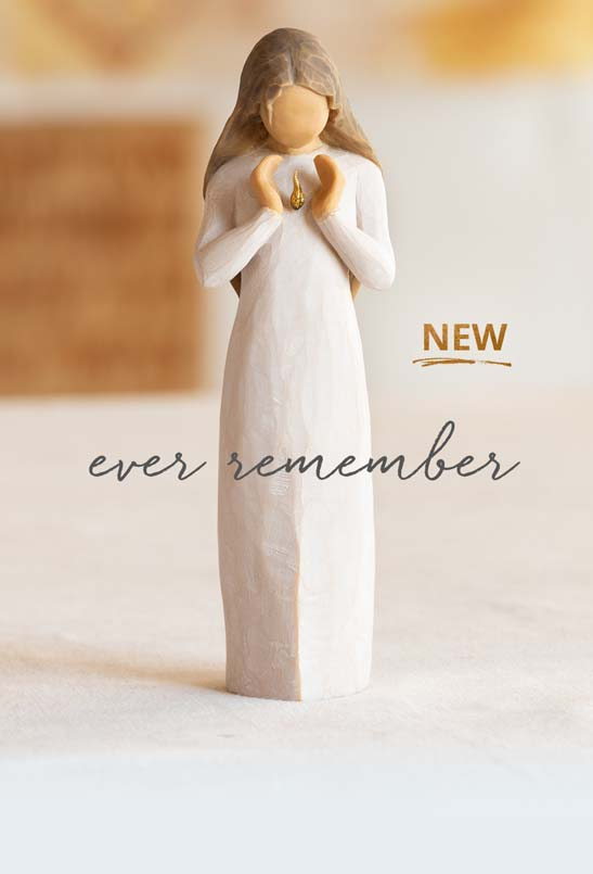 NEW Ever Remember. Hand carved figurine of a woman holding a gold flame over her heart.