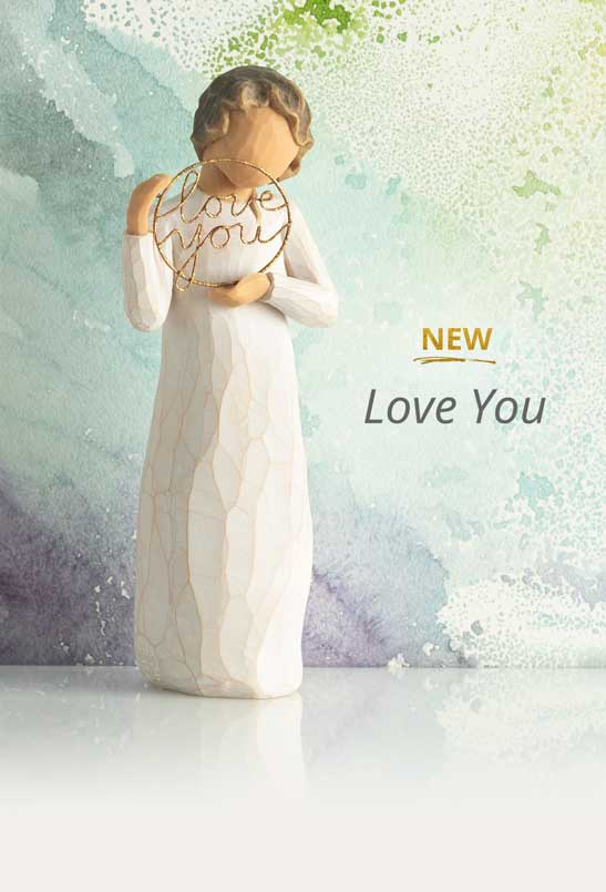 Hand carved figurine of girl holding a gold circle of the words love you. New Love You.