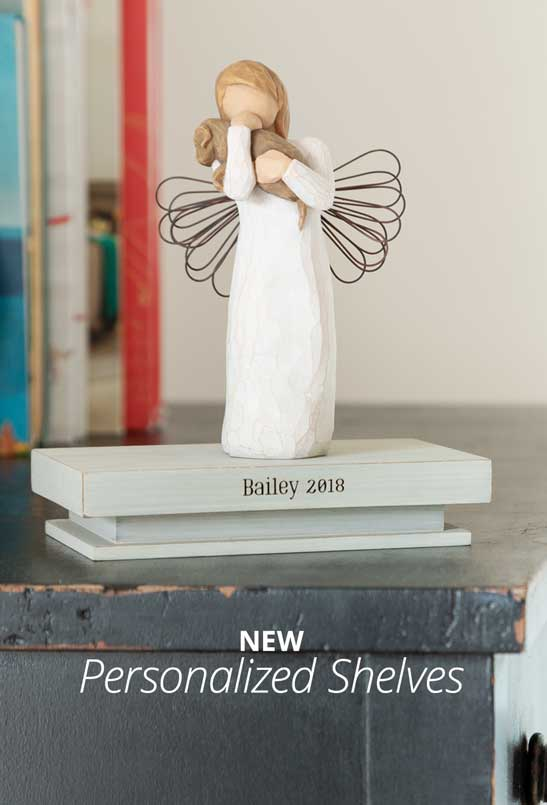 hand carved figurine of angel hugging a dog sitting on a shelf engraved with the words Bailey 2018. New Personalized Shelves.