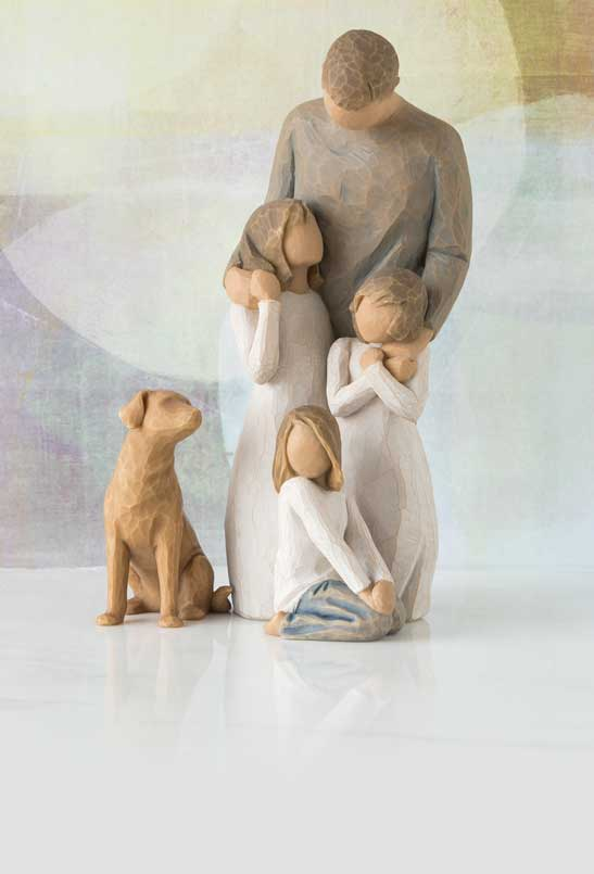 Hand-carved figurine of dad with three girls and a dog
