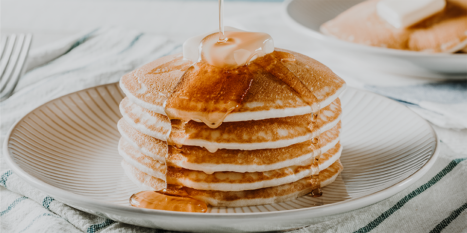 Stacked pancakes on plate