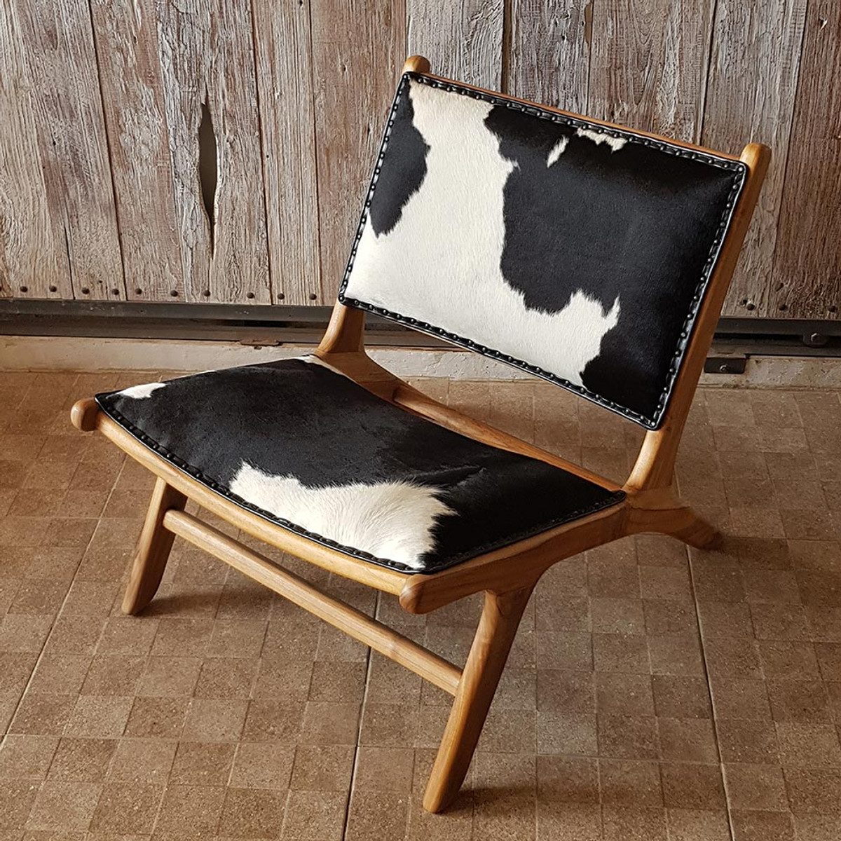 Cowhide Chair And Footstool Black White