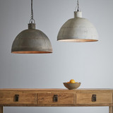 A riveted dome pendant in two rustic finishes. This pendant is designed to patina over time for a vintage aesthetic. Vintage grey and vintage white