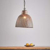 A rustic perforated pendant light with an industrial feel. This pendant is designed to patina over time for a vintage aesthetic. Small